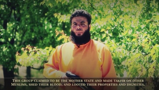 Eye for an eye: A Jaysh Al-Islam commander (pictured) reads a statement before Islamic State militants are shot from point blank range