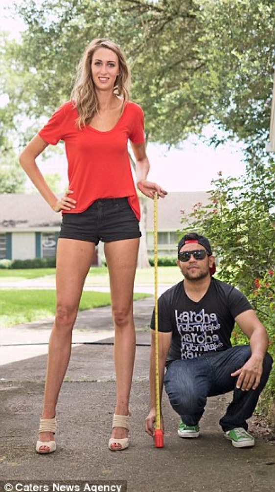 Little and large: Lauren is pictured with a male friend who can confirm her legs measure a staggering 49 inches