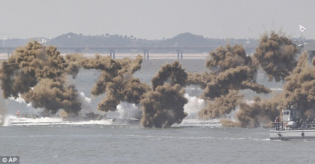 The South Korean marines performed a simulated beach landing with lots of black smoke