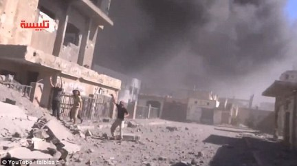 Strikes: Footage showed plumes of smoke rising above the rubble as Russian jets targeted part of Syria