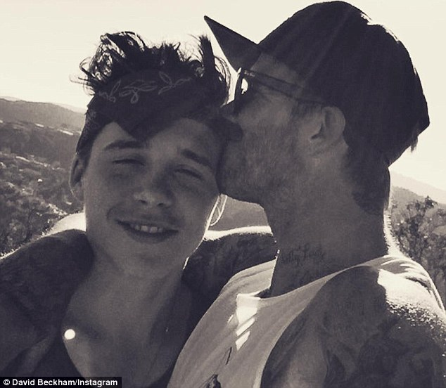 'Brooklyn gets all the attention, people ask for a photo and it's me taking it!' Brooklyn's dad David has revealed his eldest son has overtaken him in the popularity stakes
