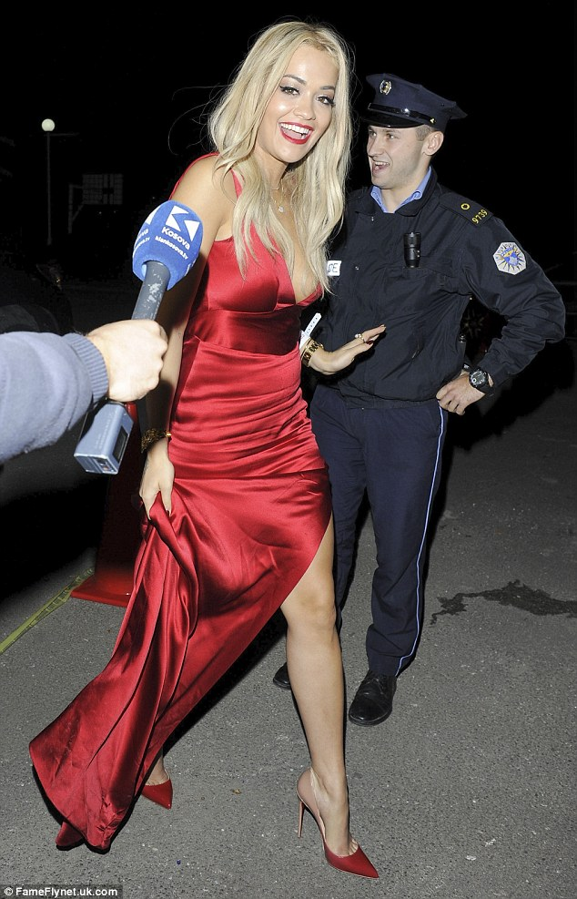 Hollywood glamour at its finest: The X Factor judge looked truly ravishing in the red thigh-split dress which also featured a short train