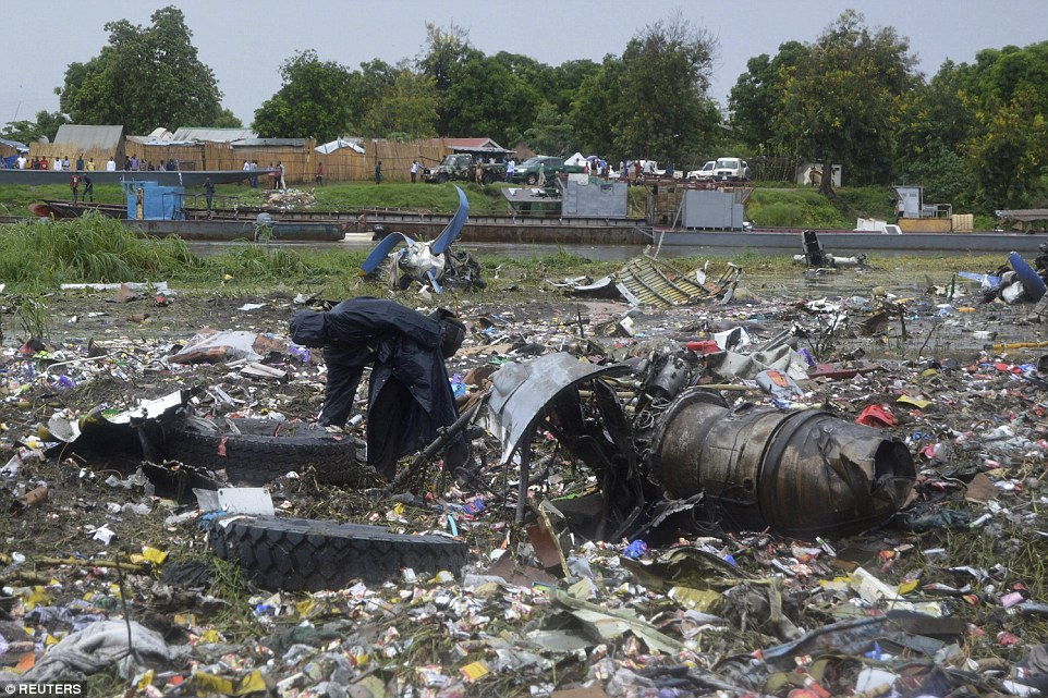 Obliterated: The crash site was just 800 metres from the runway it took off from in the South Sudanese capital of Juba