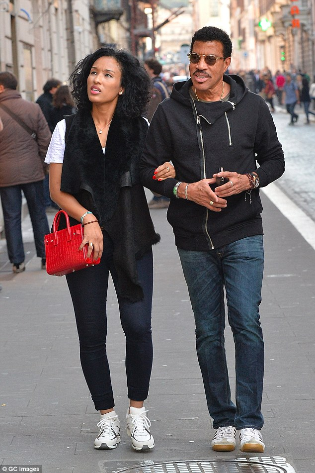 Romantic stroll:66-year-old Lionel Richie was seen taking time out from work on Thursday as he and his much younger girlfriend, Lisa Parigi wandered through the historic streets of Rome