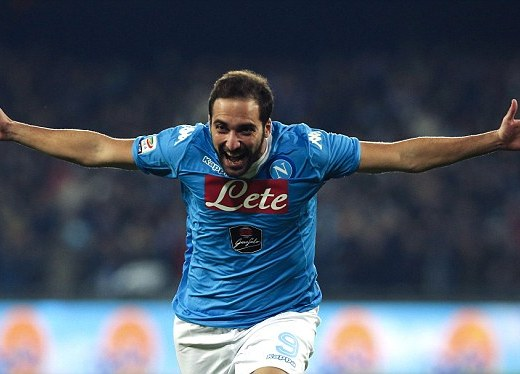 Gonzalo Higuain celebrates one of his two goals in Napoli's 2-1 win over Inter Milan that took them top