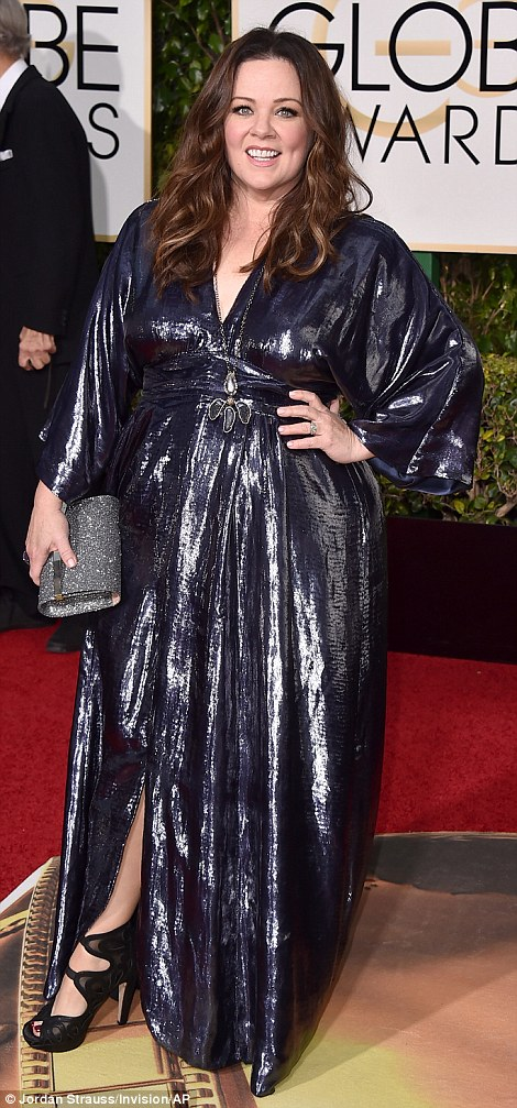 Hiding away: Despite losing an impressive 50 pounds, funny lady Melissa McCarthy didn't opt to show off her figure at all in this draping, shiny outfit