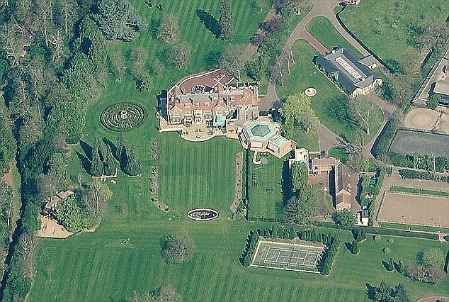 The Pirelli calendar girl claims that her 60-year-old sheikh ex-husband Walid Juffali has cut the number of staff at her £100m mansion house (pictured), which is just four miles from Windsor Castle