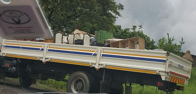 Personal effects: The Rankins' belongings are seen being thrown into the back of a truck during the eviction