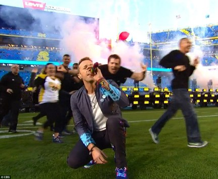 Look at the stars: Chris began the performance on the field as he sung the chorus of old hit Yellow