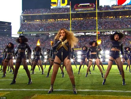 The superstar had been expected to deliver a political statement during her performance of new single Formation after releasing the video yesterday which featured graffiti reading 'stop shooting us'. Above she and her dancers are pictured performing at the Super Bowl