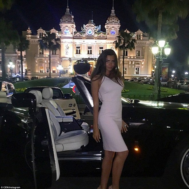 A young woman identified as Anna Fursova stands next to an impressive-looking sports car outside the Casino de Monte-Carlo