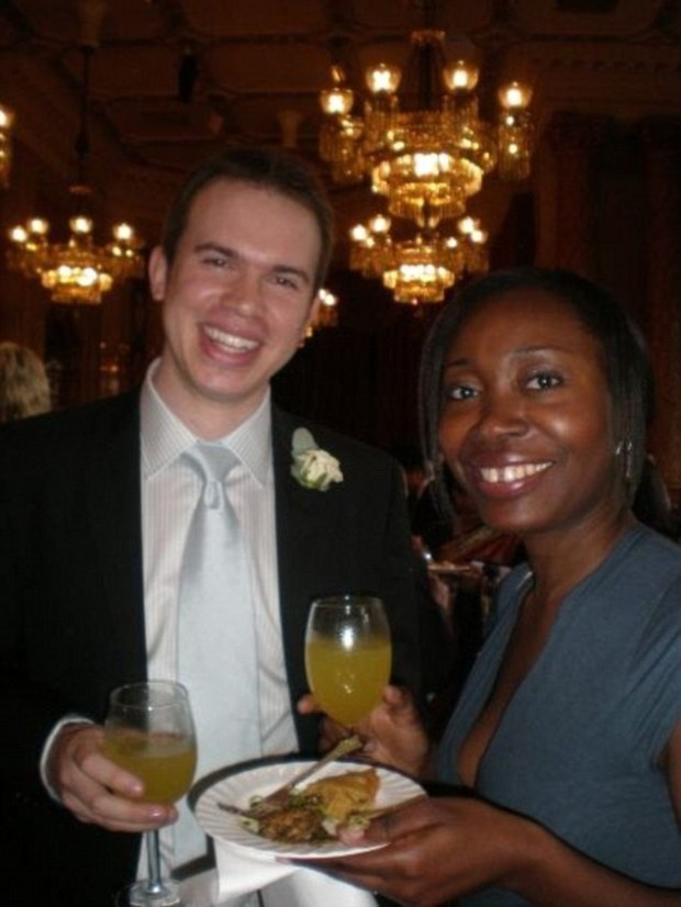 Tribunal:Sheyi Pemsel is thought to be standing by her husband Rupert (pictured together at a wedding in 2009) despite him admitting he paid a prostitute for sex while on duty in a maternity hospital