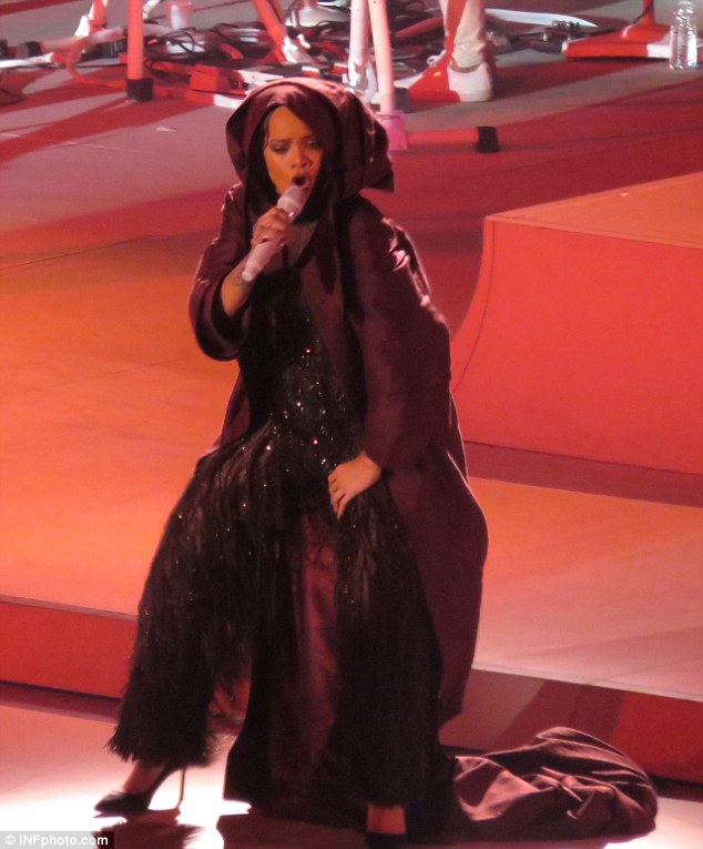 Cape-tastic:Before exposing all, she sported a huge hooded cape initially before whipping it off and revealing her phenomenal ensemble beneath