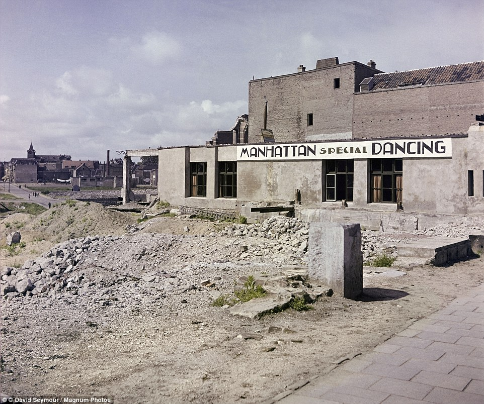 This photo takenNijmegen in 1947 shows much of the city still remained in ruins - though one building is dedicated to a Manhattan-style dance night. The city was badly damaged in bombing raids because U.S. pilots thought they were bombing the German city of Kleve