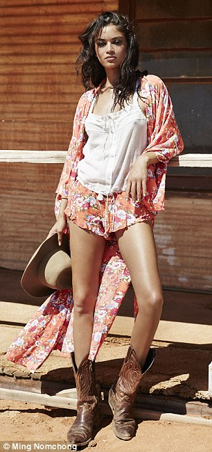 Red hot: The mixed-race stunner flashed her toned pins in a pair of printed shorts and cowboy boots in one image