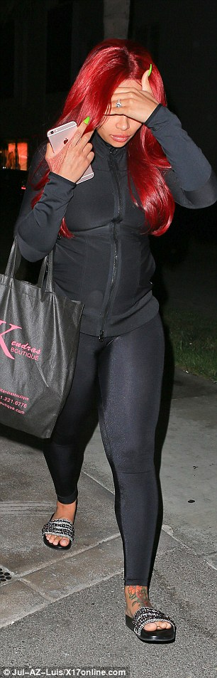 Those aren't Louboutins:The future daughter in law of Kris Jenner, 60, also wore jazzy slides that showed off her foot tattoo