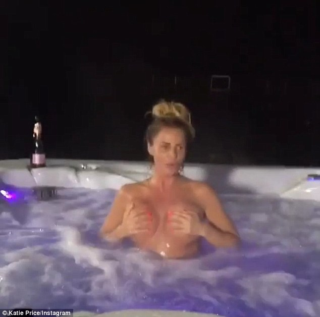 Loving life: Showing off her fun side, the Loose Women regular pulls funny faces as she jumps up and down in the bubbles, a bottle of prosecco on the side of the tub