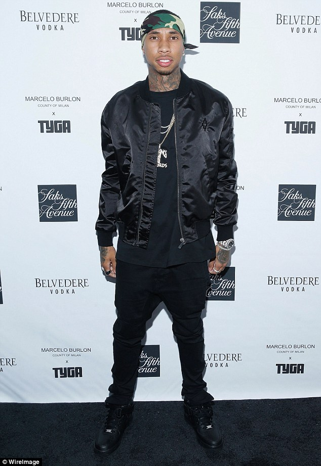 What a guy: Tyga - pictured on May 12 - plunked down around $200k to buy a member of his crew a new Lamborghini at Scott Disick's Calabasas Luxury Motorcars on Wednesday