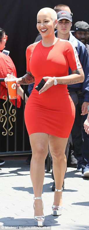 Legging it: The 32-year-old star wore a very tight red dress and towering platform heels as she arrived at Universal Studios