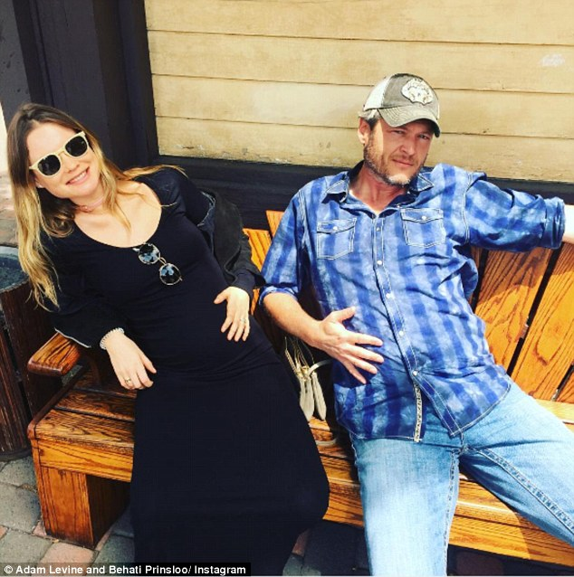 Pregnant people! The Voice co-star jumped in on some fun rubbing his 'pregnant' belly while posing with Behati