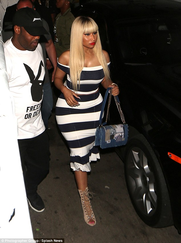 Girlfriend duties: Nicki Minaj made the most of boyfriend Meek Mill's night out as she stepped out in West Hollywood on Friday to support him at a club performance