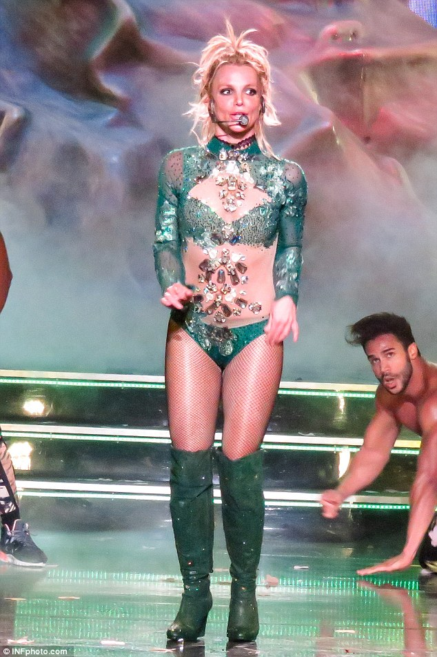 Gorgeous in green : The blonde beauty coupled her sheer, green ensemble with a pair of thigh-high, green boots