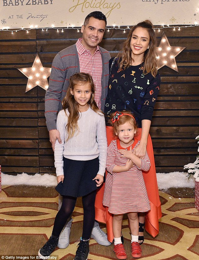 """Of starting a family with husband Cash Warren, Jessica revealed'It was not planned, but I was like, """"OK, this is where my life is going,""""' The couple are pictured in December with daughters Haven and Honor"""