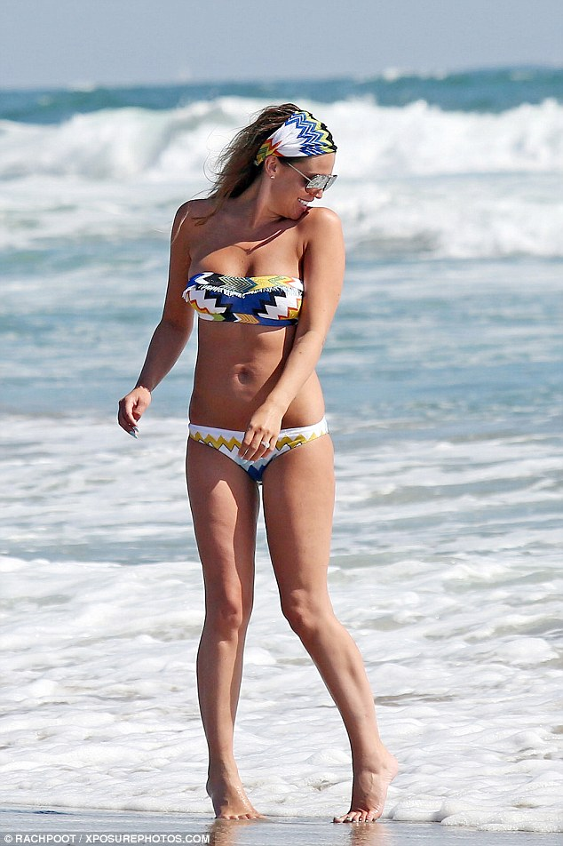 Figure-ing it out: The mother-of-three showed off her bodacious behind in the swimsuit as her skimpy bikini bottoms exposed her shapely curves