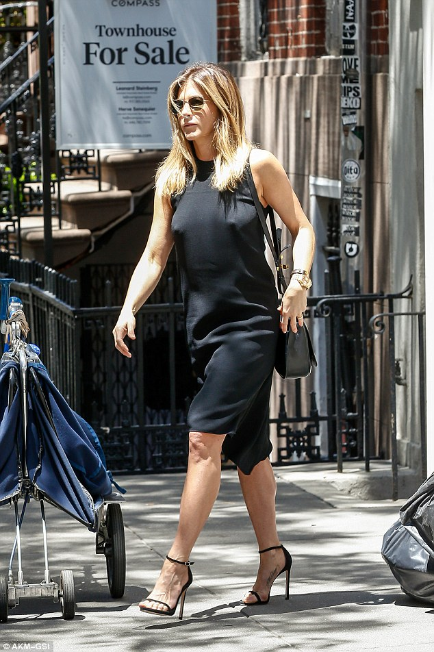 Simple yet striking:Jennifer Aniston embraced a simple fashion aesthetic on Thursday in New York