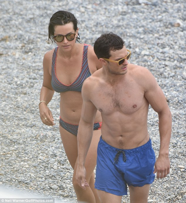Loved-up!Jamie's wife, Amelia Warner, got in on the fun as she joined the actors in a chevron print bikini in hues of blue and peach