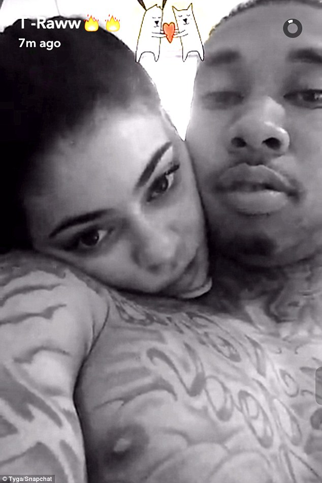 True love: Tyga shared a black and white photo to Snapchat on Tuesday of girlfriend Kylie Jenner cuddling him as the 18-year-old supports him on his European tour