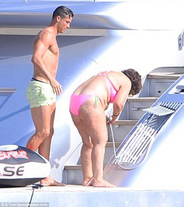 Fun in the sun: Joining the Portuguese superstar was his mum Delores and son Cristiano Jr, and the family frolicked in the sun on the back of a luxury yacht