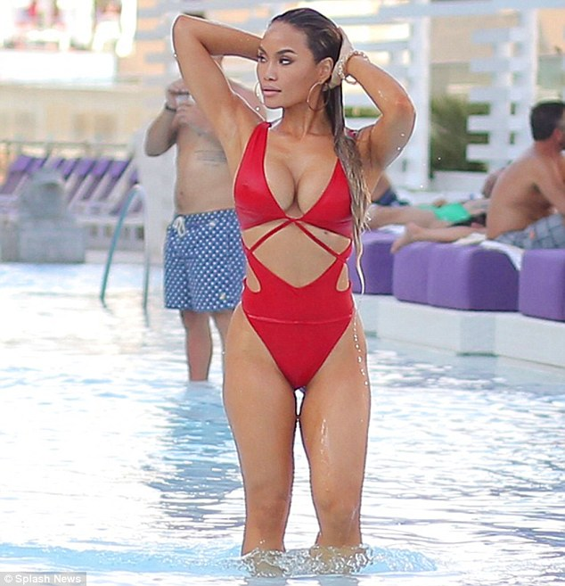 Taking the plunge: Daphne's cut-out monokini also boasted a low-cut neckline, allowing her to flash her generous cleavage