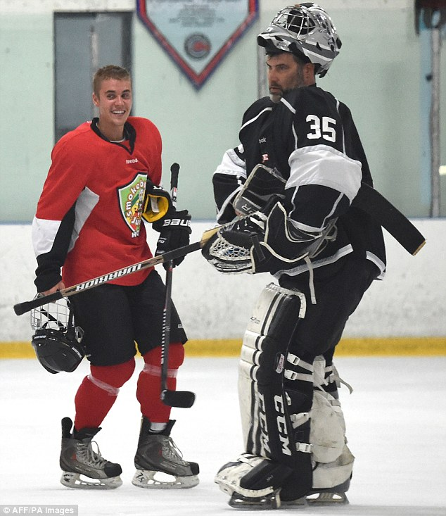 Hockey time: Justin seemed in good spirits as he took part in an ice hockey game in the San Fernando Valley, California on Monday night amid the furore