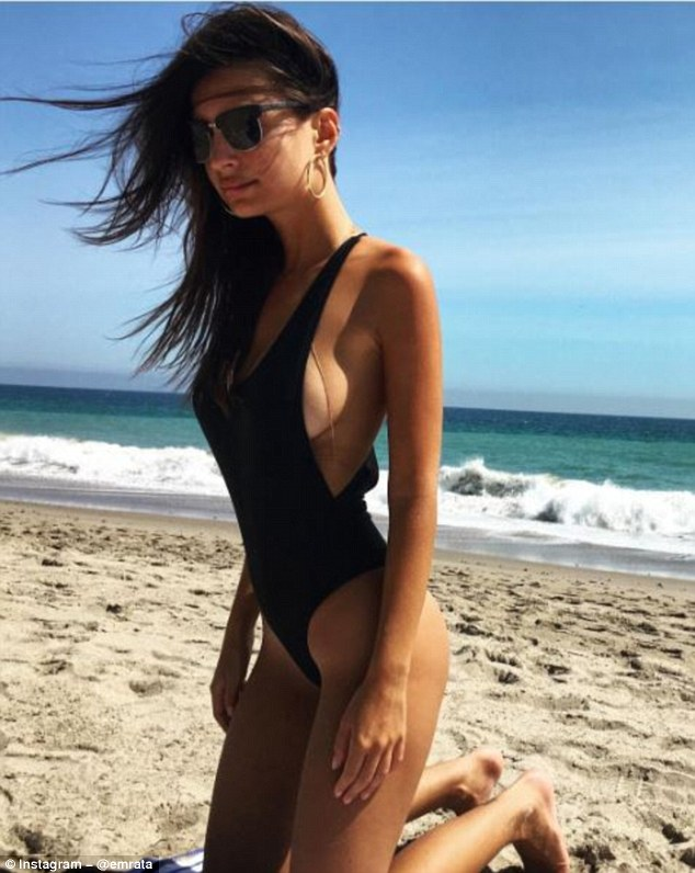 Racy: Emily Ratajkowski wasn't shy displaying some serious sideboob in a daring black one-piece on Instagram on Saturday