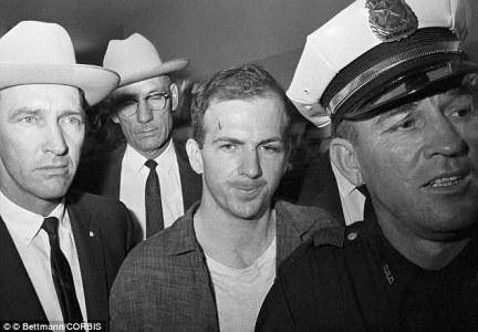 Lee Harvey Oswald (center) was accused of shooting the president from the sixth floor of the Texas School Book Depository