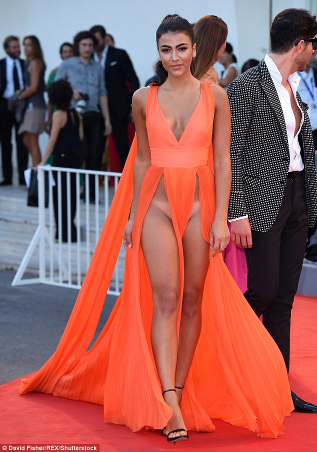 Model Giulia Salemi showed off her tan lines in a dress that was practically slashed to the navel on both sides at the premiere of The Young Pope in Venice