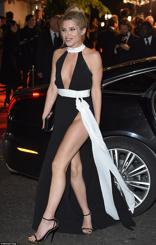 Singer Mollie King braved freezing temperatures to showcase the daring look at the British Fashion Awards in November 2015
