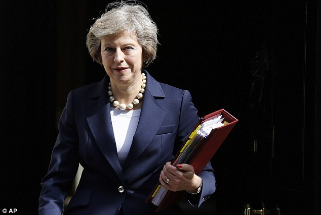 While former Prime Minister David Cameron and cabinet ministers including ex-Justice Secretary Michael Gove reportedly wore the Cupertino brand's smartwatches in the past, a ban has been put in place under the leadership of Prime Minister Theresa May (pictured)