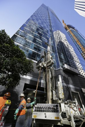 The Millennium Tower, which stands 58-stories high, has been dubbed the 'leaning tower of San Francisco' after the multi-million building began to sink (independent soil engineers install data collection devices and obtain soil samples outside the tower for analysis)