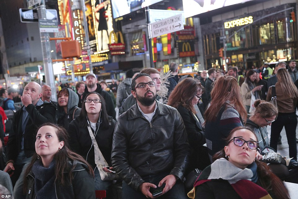 Feeling blue: Hillary Clinton supporters in New York grew visibly gloomy as the US map slowly turned red and Trump's ascension to President became inevitable