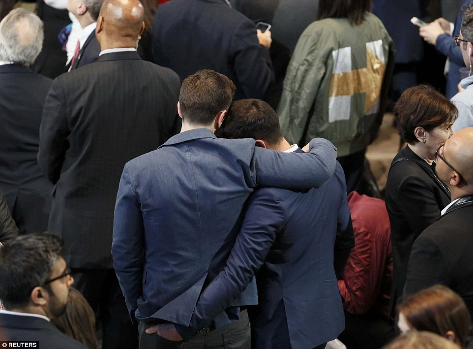 Consolation: Two Clinton supporters lean on each other for help as Manhattan shortly before Manhattan learned that Clinton's loss was certain