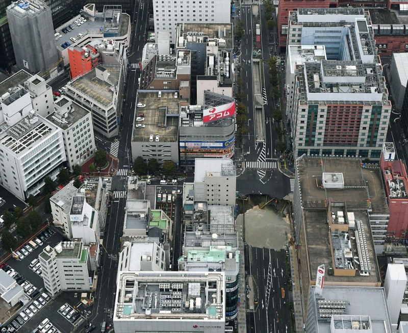 Scale of the problem: An aerial photo of the city's business district shows the size of the gaping sinkhole which opened up