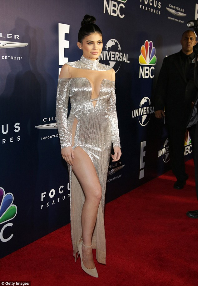 Silver lining: Kylie wore a sparkling silver gown with a bejewelled choker as she pinned her hair in a high bun