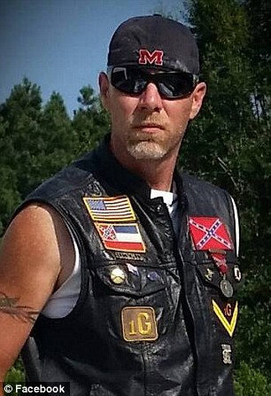 Leader: Protest leader Kevin Nelms said he wanted 'several' Christian flags put up in response. Just one person had complained about the flag, the Foundation admitted