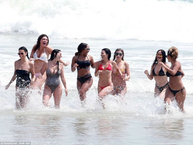 The crew! Kim's group of friends included her sister Kourtney, who wore a hot pink bikini, centre