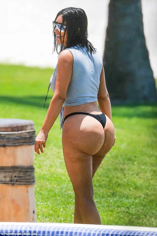 Backlash: Kim Kardashian has lost 100,000 Instagram followers after paparazzi pictures of her natural backside  led fans to accuse the mum-of-two of turning to surgery and Photoshop to maintain the social media image of her flawless body