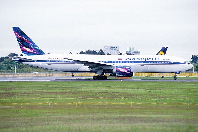 The plane - a Boeing 777 (file picture) and packed with tourists - hit several successive areas of turbulence en route to Bangkok
