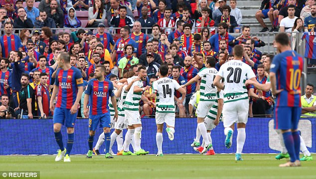 Eibar players celebrate following their shock opening goal inside ten minutes at the Nou Camp