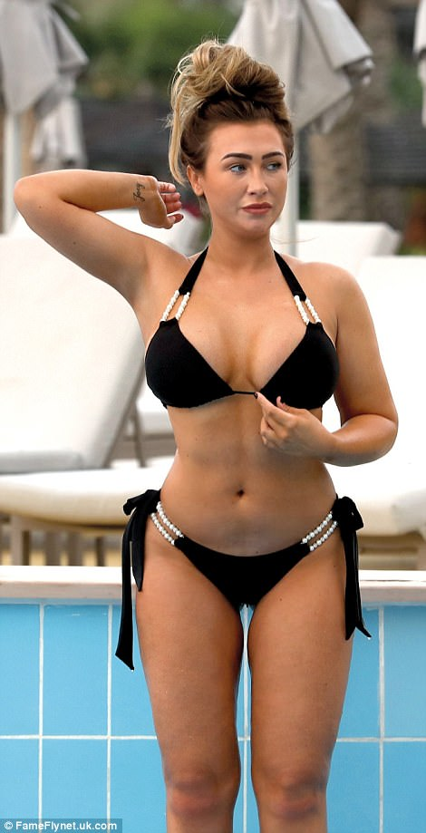 Sensational curves: Lauren Goodger was proudly flaunting her physique in a black bikini during her recent Dubai getaway, displaying her voluptuous derriere and generous cleavage in a black bikini